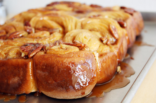 orange pecan sticky buns on baking sheet