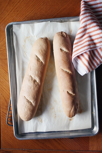 baguette loaves on baking sheet