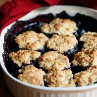blueberry cherry cobbler in baking dish