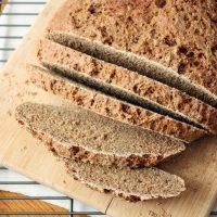 russian black bread loaf on cutting board