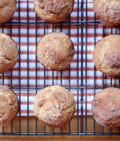 cider doughnut muffins on a cooling rack