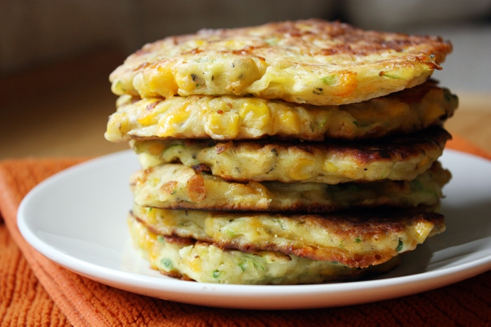 stack of zucchini corn pancakes on a plate