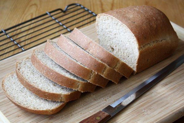 ricotta olive oil herb bread sliced on cutting board