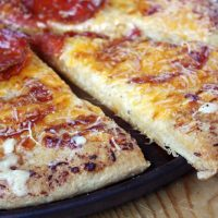 pepperoni pizza slice with garlic bread crust