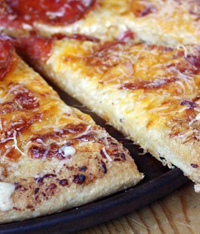 pepperoni pizza slice with garlic bread crust
