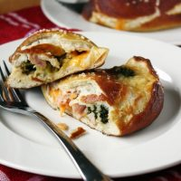 ham and cheddar stuffed pretzel calzones on plate
