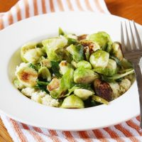 sauteed brussels sprouts with couscous in bowl