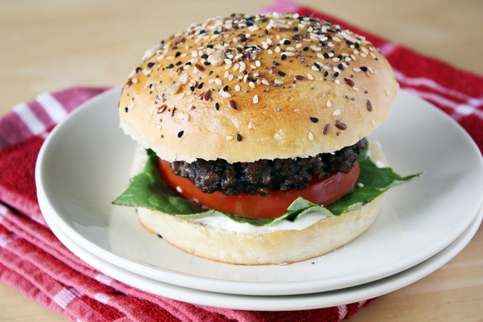 hamburger with brioche hamburger bun with seeds on plate