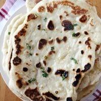 butter garlic naan on plate