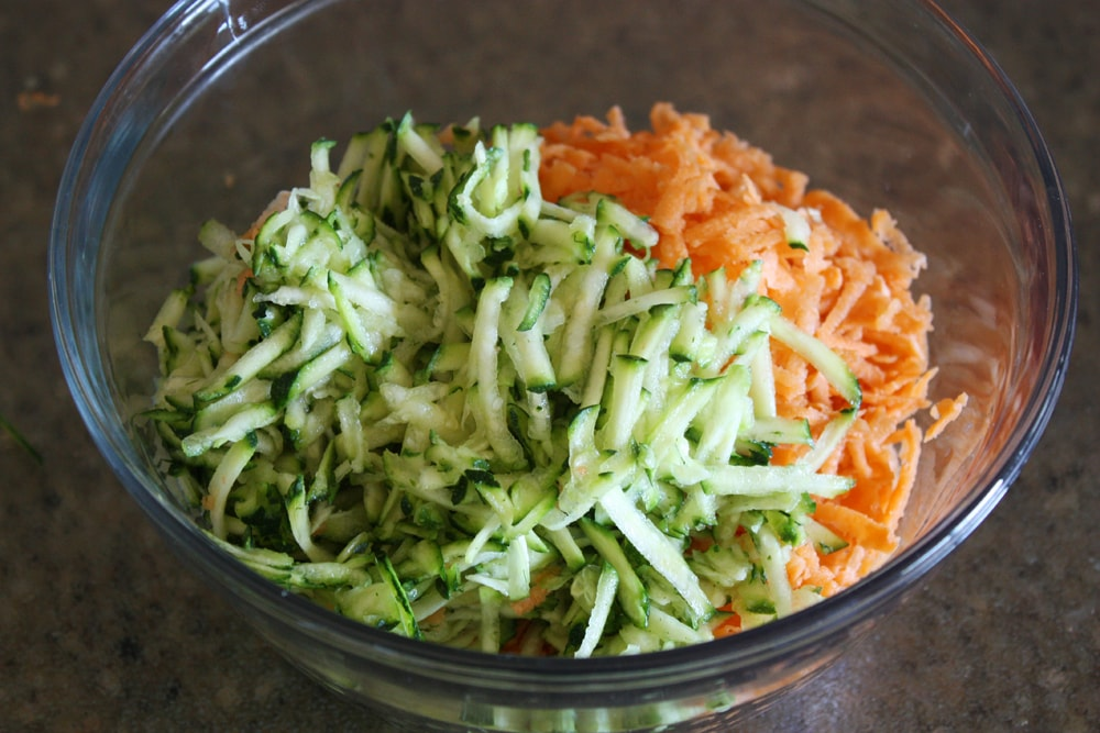 shredded sweet potatoes and zucchini in a bowl