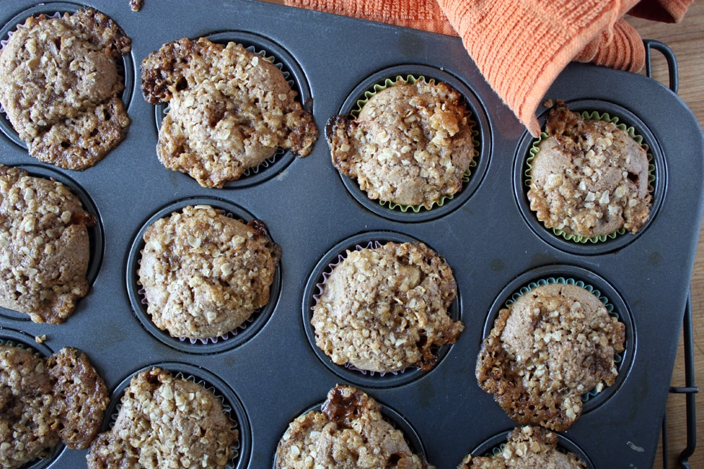 baked caramel pear muffins in muffin pan