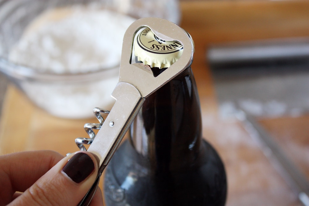 opening stout beer bottle