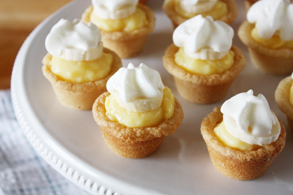 mini banana cream cookie pies on cake stand
