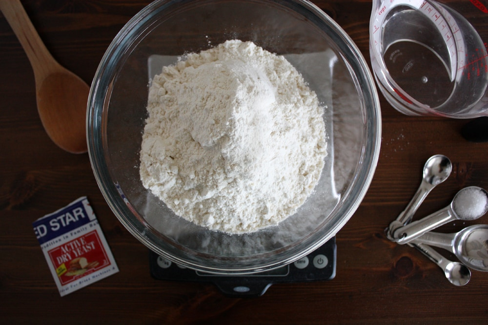 measuring flour in a bowl