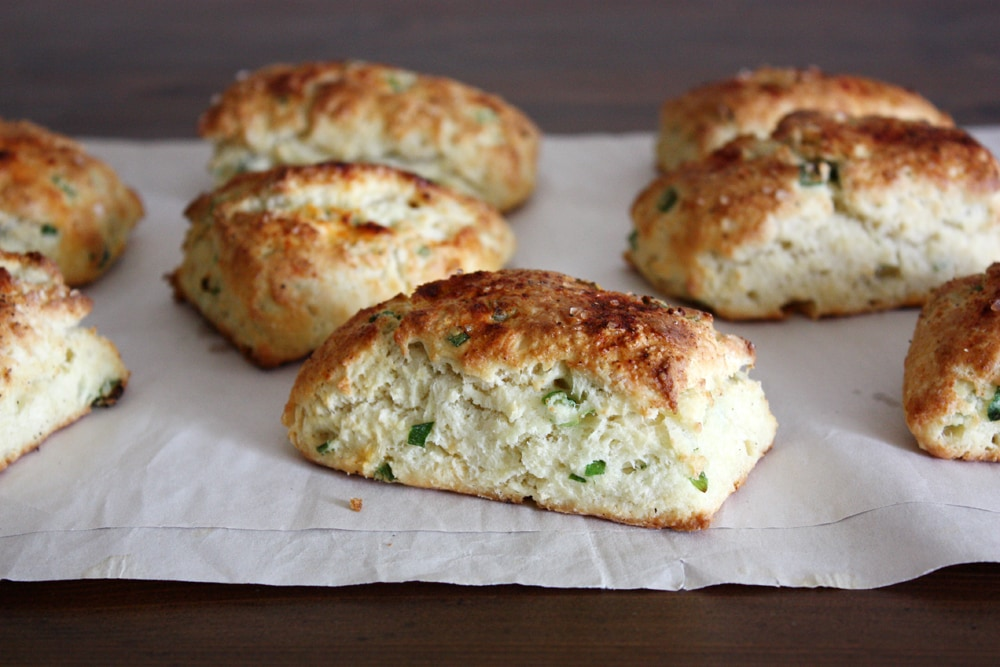 ricotta scallion scones on parchment paper