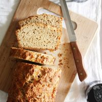 gruyere rosemary beer bread on cutting board