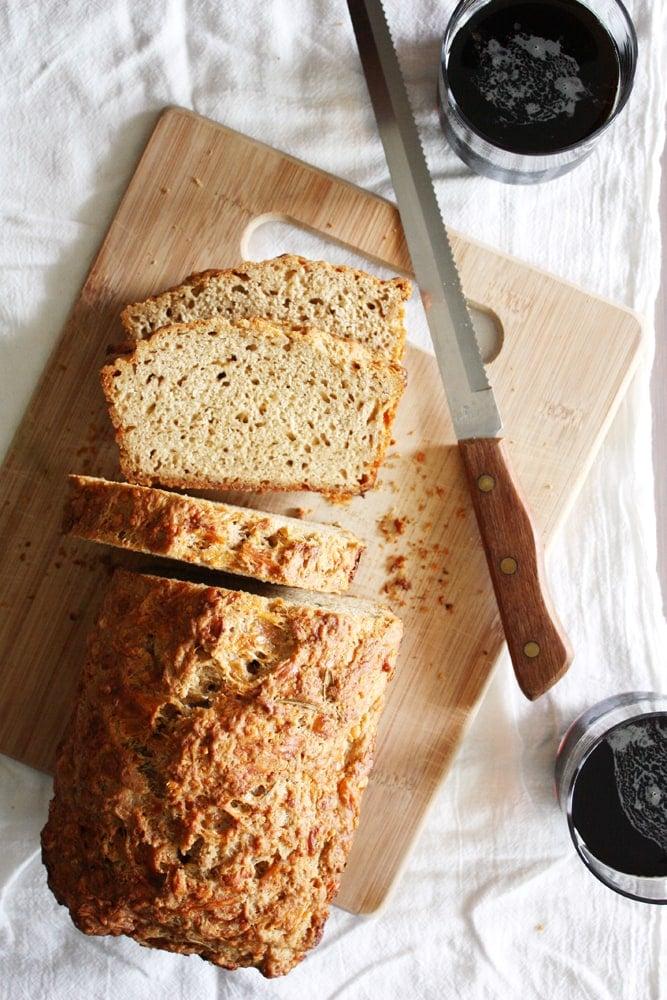 gruyere rosemary beer bread on cutting board