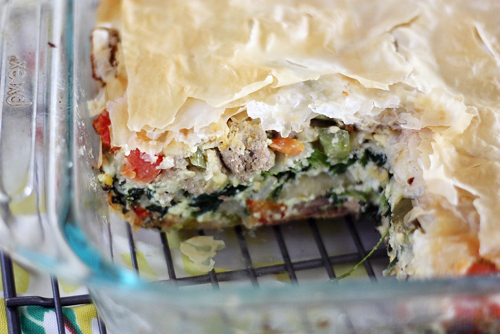 serving taken from phyllo egg brunch casserole in baking dish