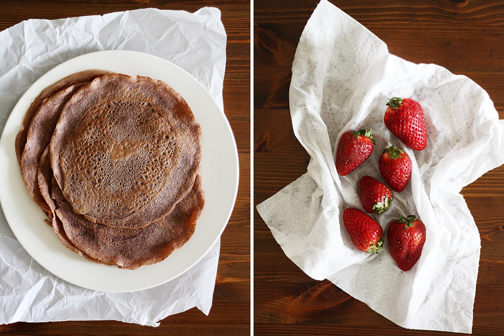 finished chocolate crepes on a plate and strawberries