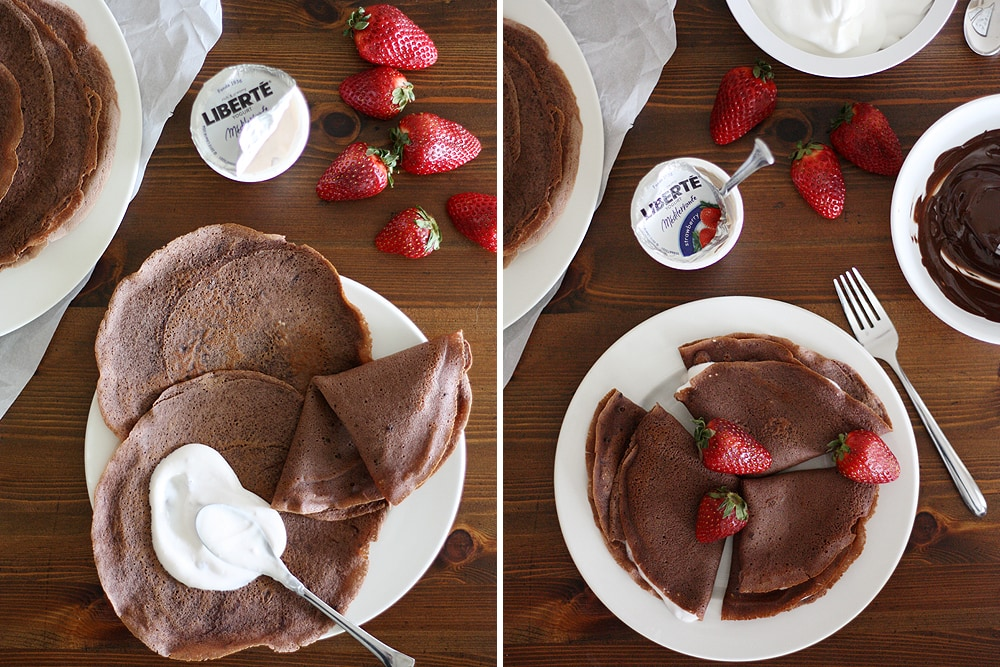 placing strawberry yogurt inside dark chocolate crepe