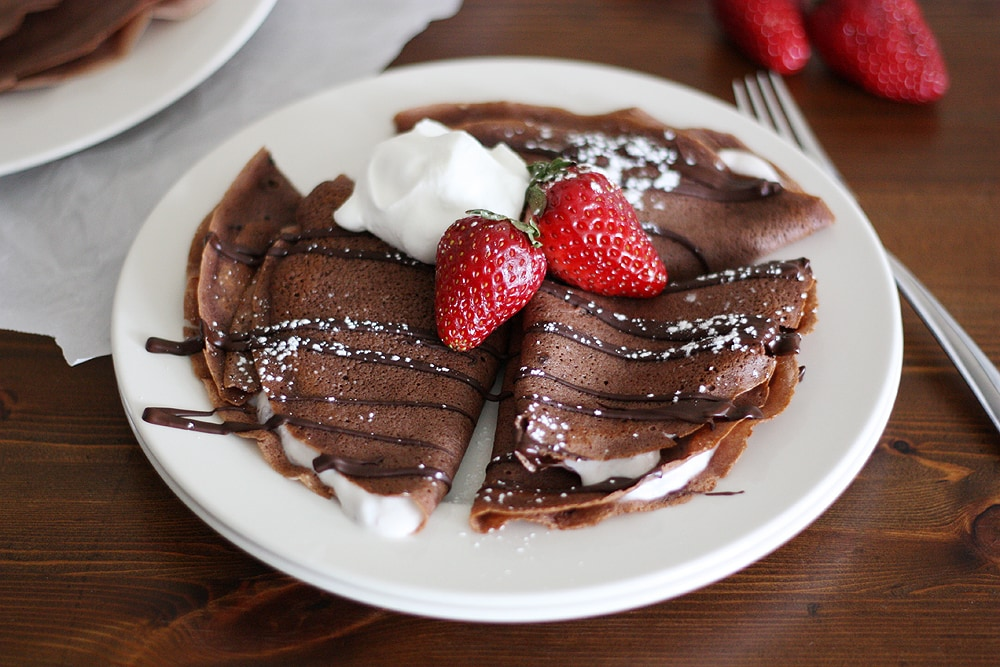 dark chocolate crepes with strawberry yogurt on a plate