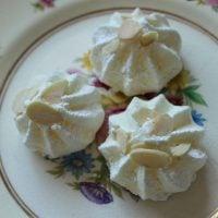 orange almond meringues on a plate
