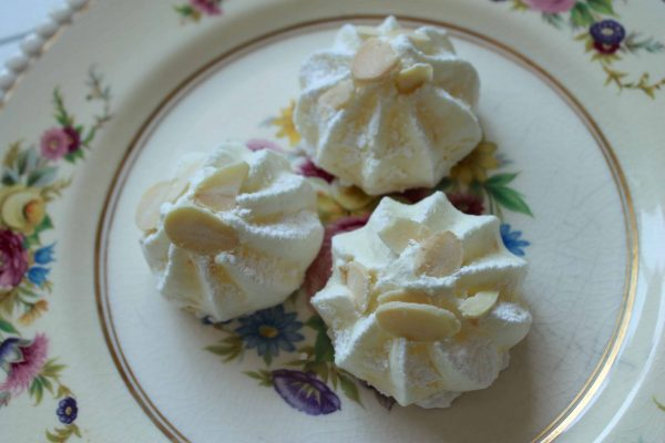 orange almond meringues on a plate