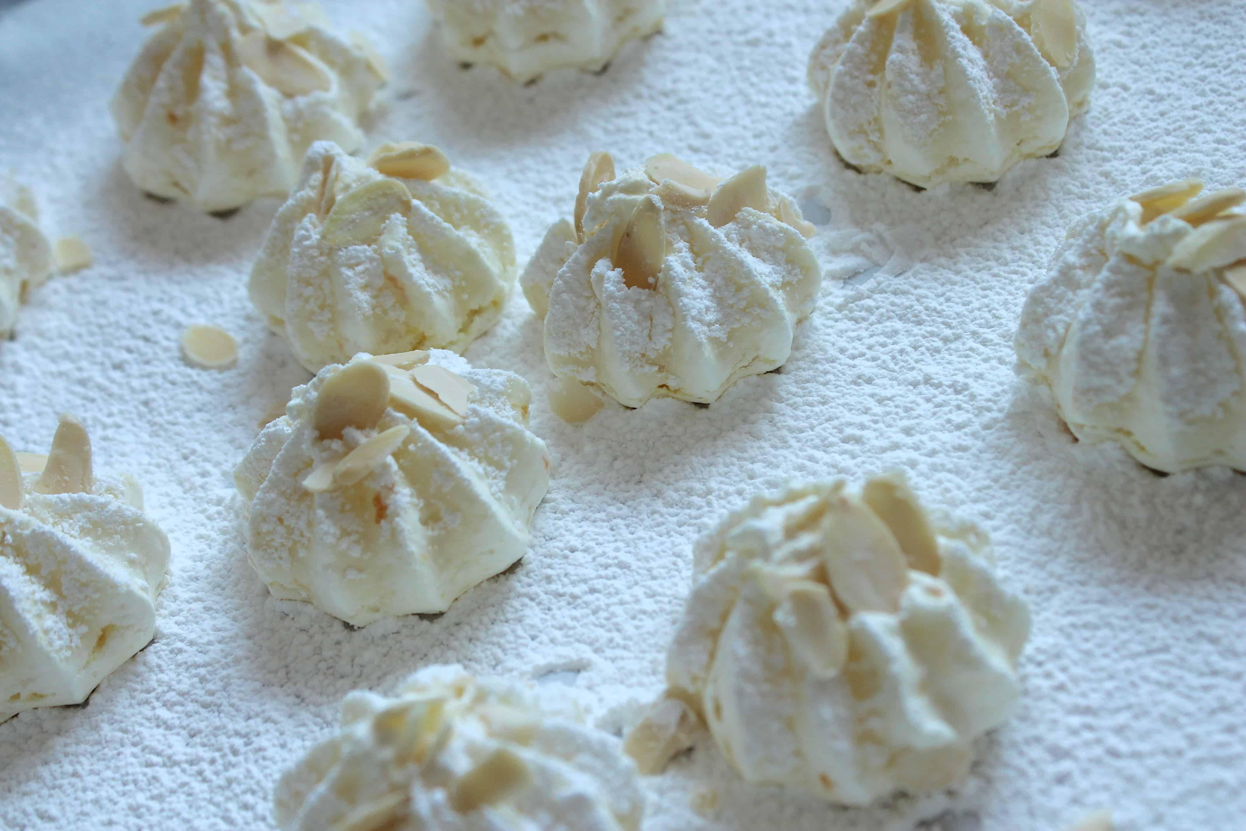 orange almond meringues on parchment paper