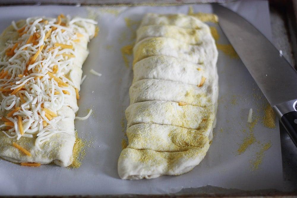 folding stuffed cheesy bread dough