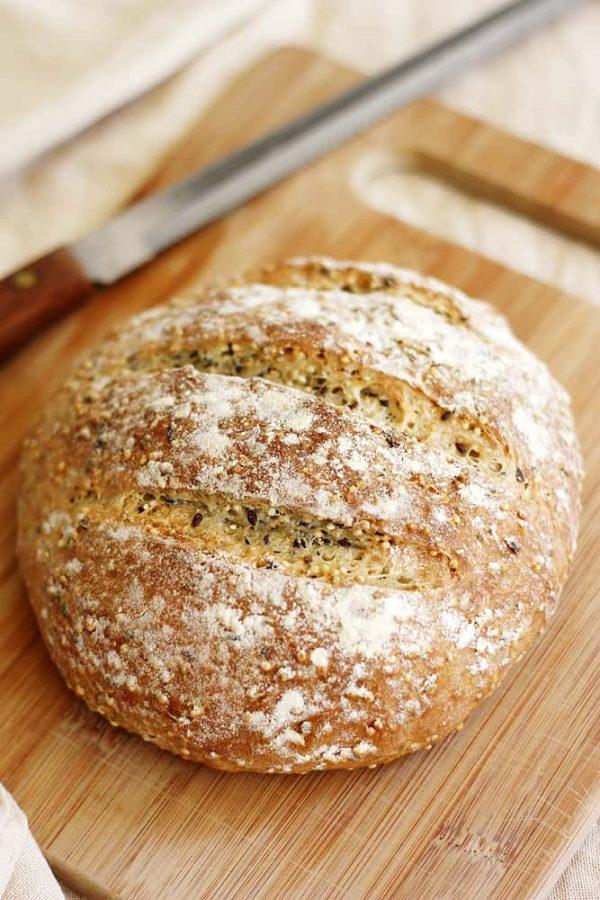 crusty no knead bread on cutting board