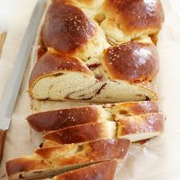 fig raspberry and sea salt challah bread on cutting board