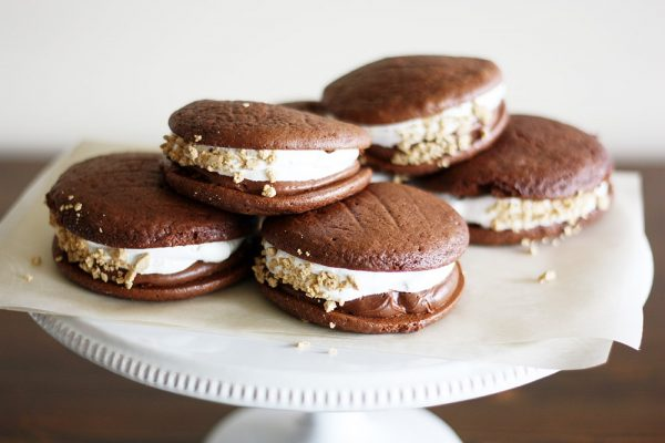double chocolate s'mores whoopie pies on a cake stand
