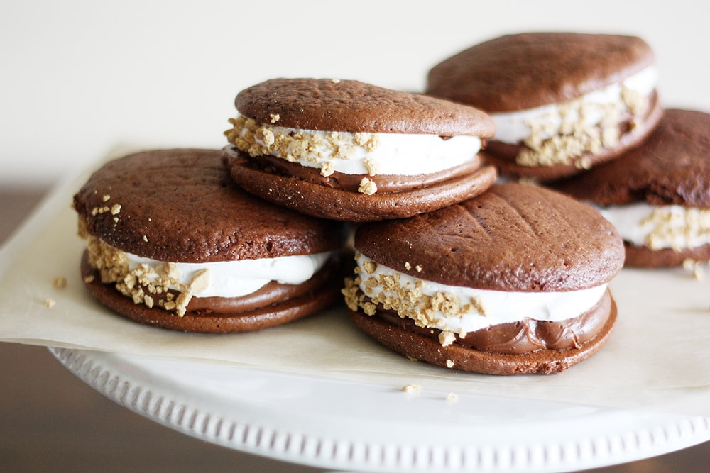 Double chocolate s'mores whoopie pies on cake stand