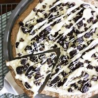 cookies and creme dessert pizza on a baking pan