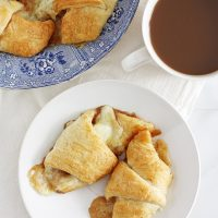 brown butter apple cheddar pie crescent rolls on plate
