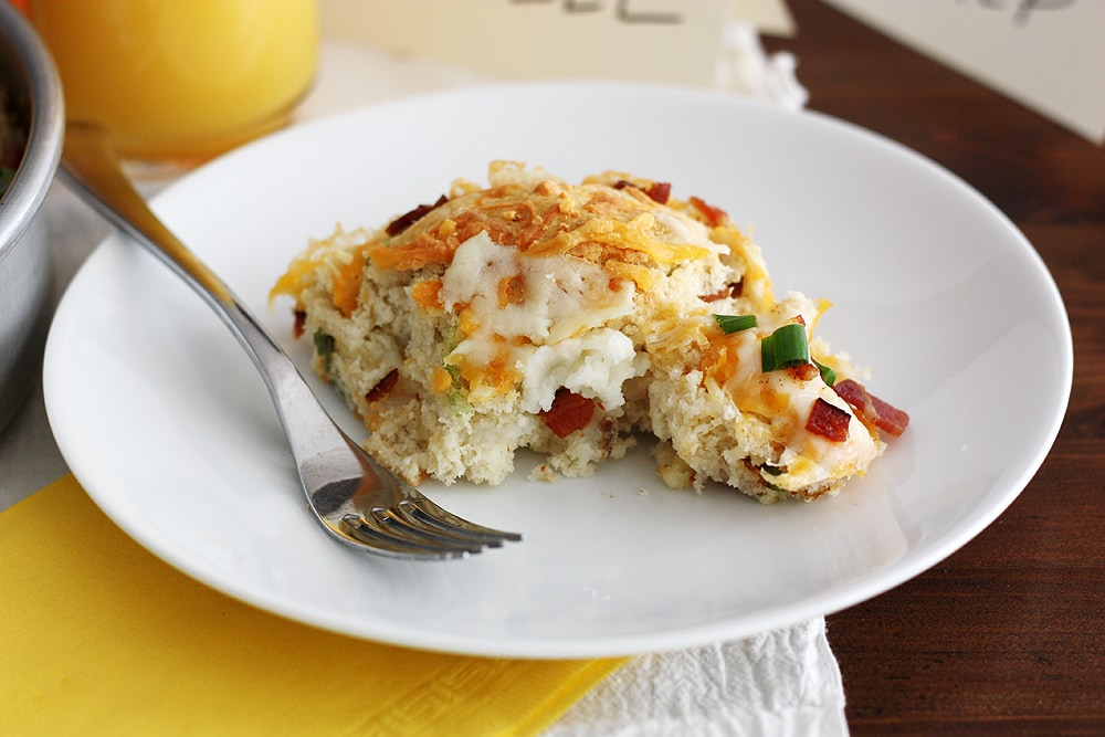 loaded mashed potato stuffed biscuit on a plate