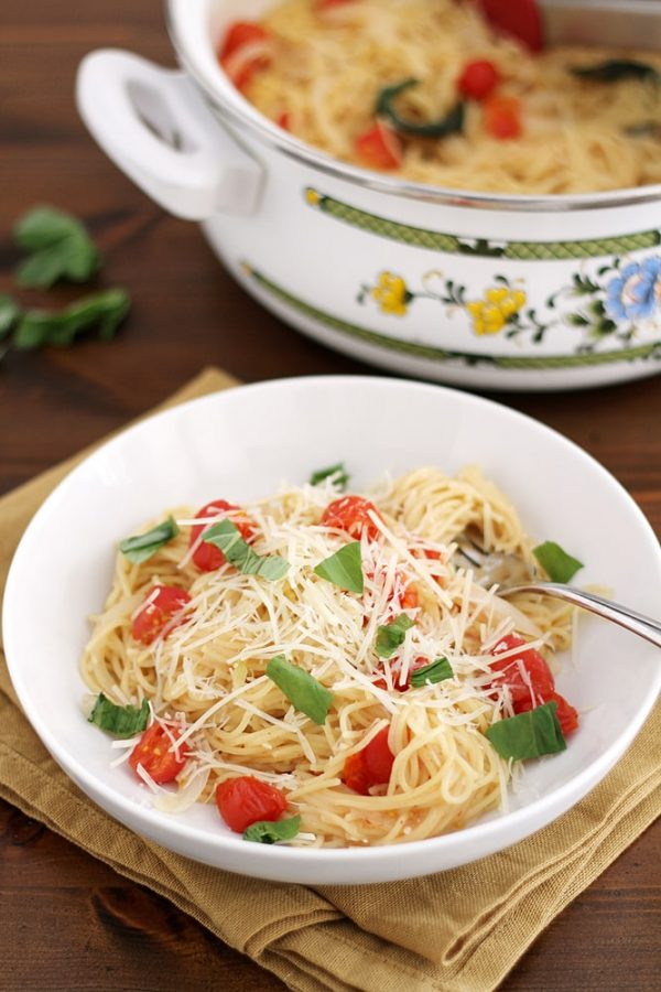 pasta with tomatoes and basil in a bowl