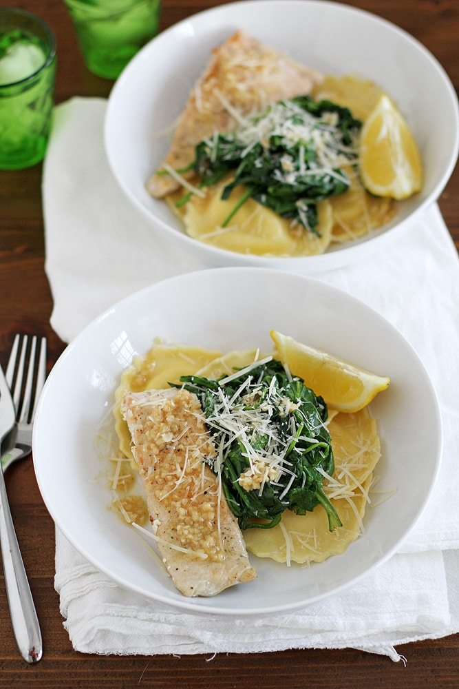 two bowls of salmon ravioli on a table