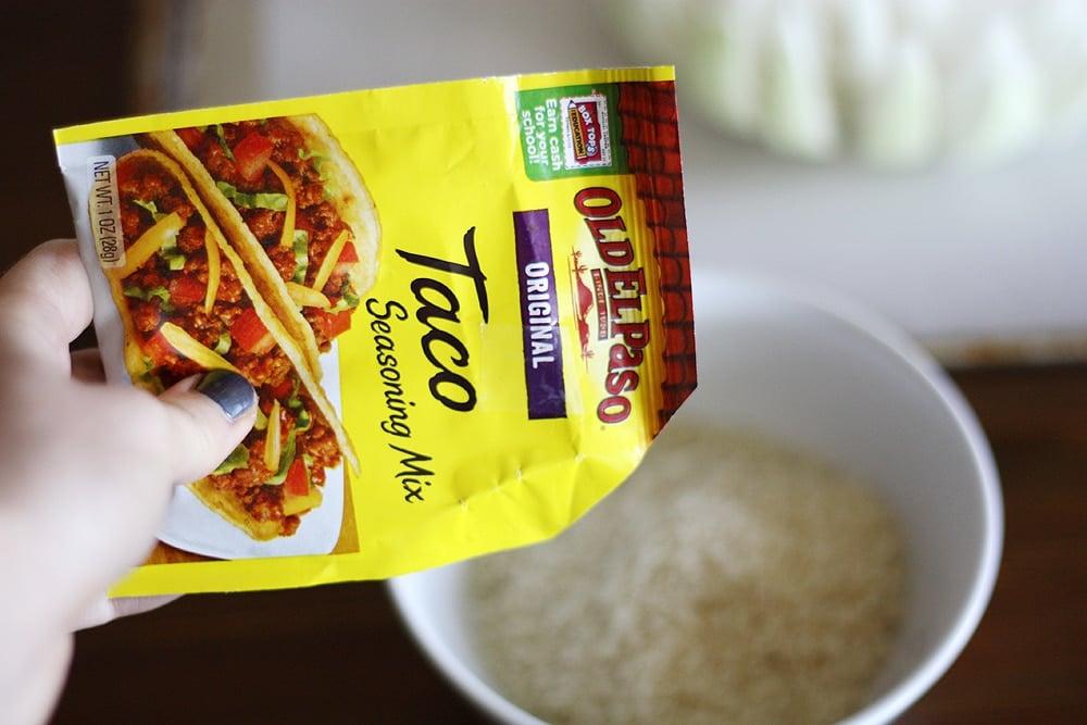 adding taco seasoning to seasoning mix bowl