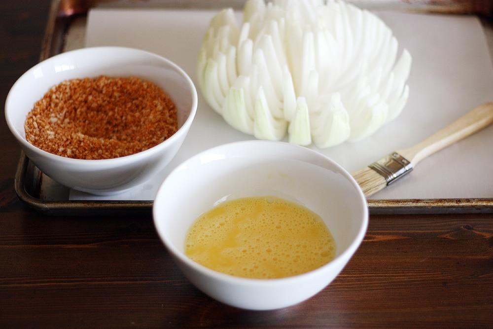 preparing the blooming onion for seasoning