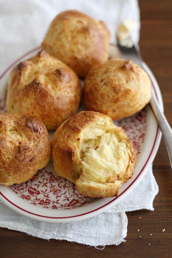 garlic cheddar brioche buns on plate