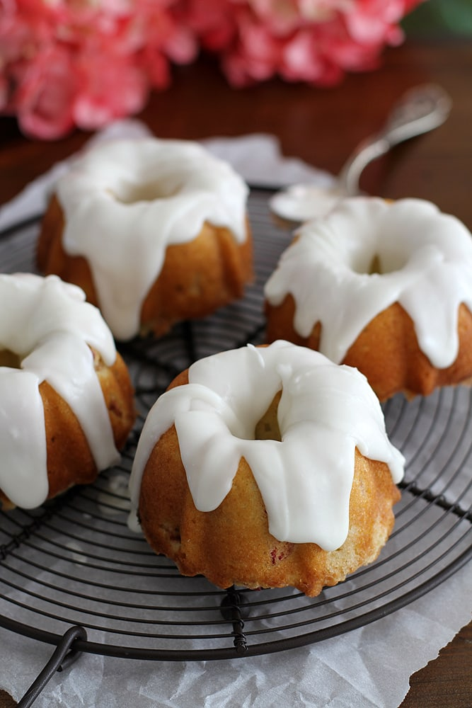 mini lemon rhubarb bundt cakes on cooling rack