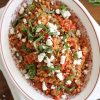 farro with tomatoes and feta in serving dish