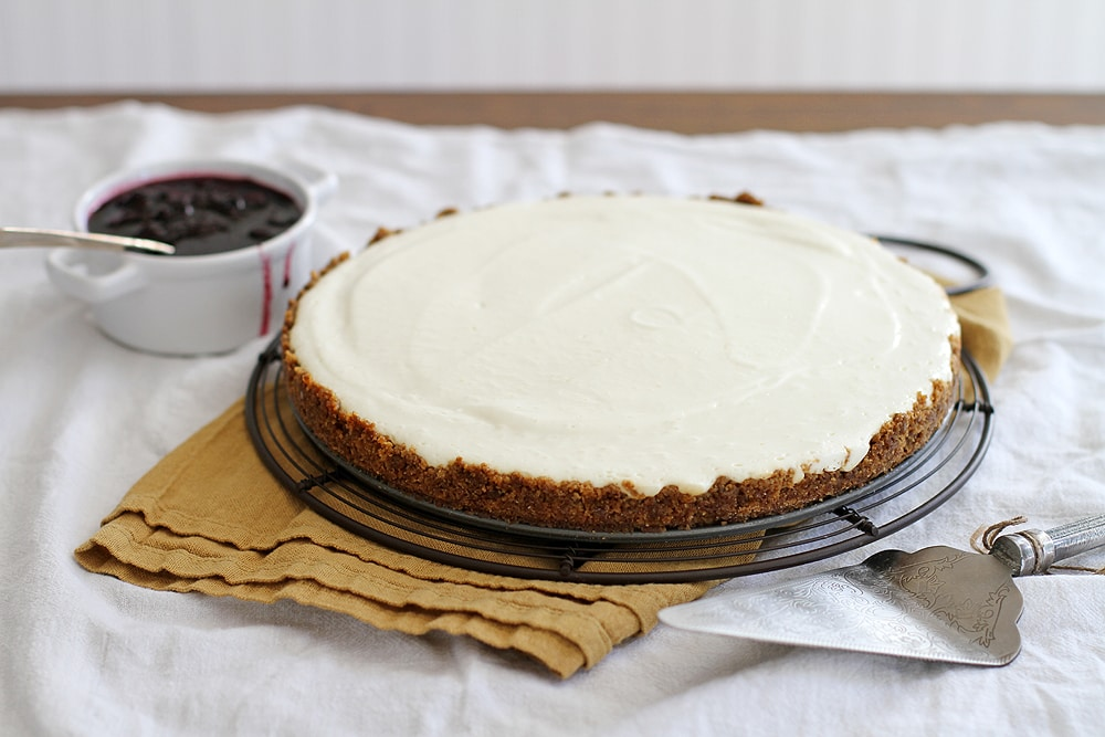 lemon ginger panna cotta cheesecake on cooling rack