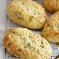 asiago herb hoagie rolls on cooling rack
