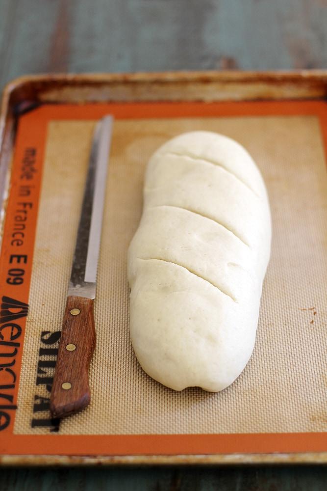 loaf of Italian bread on a baking sheet