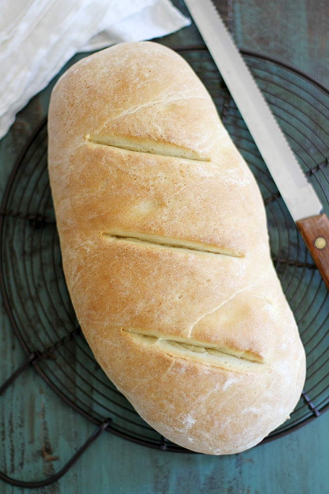 loaf of Italian bread on a cooling rack