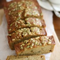pumpkin zucchini bread sliced on cutting board