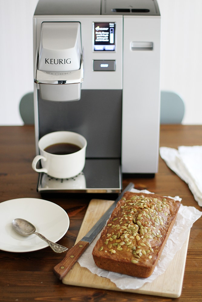 pumpkin zucchini bread next to keurig machine