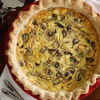 shallot mushroom quiche on table